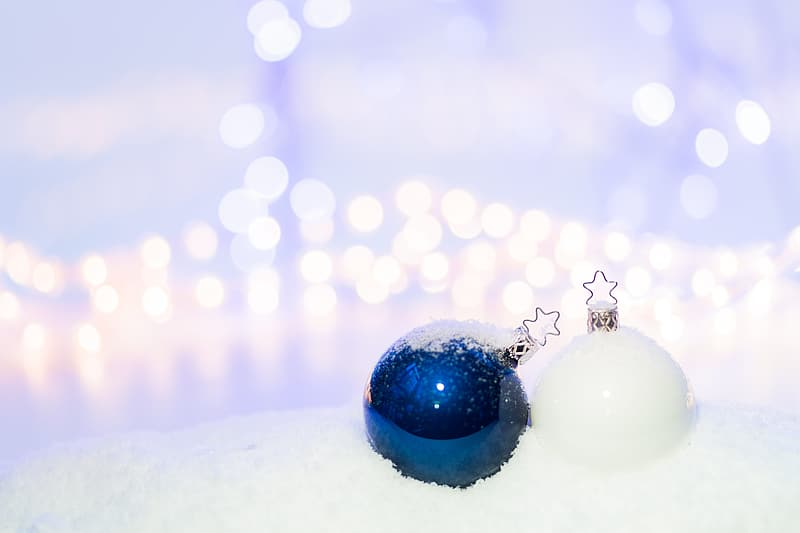 Blue baubles on snow covered ground