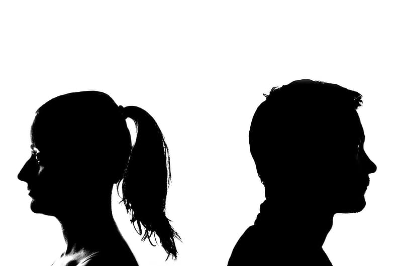 Silhouette photo of man and woman behind each other