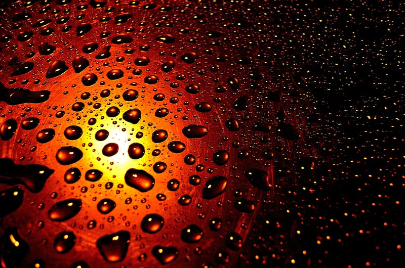 Droplets on brown glass surface
