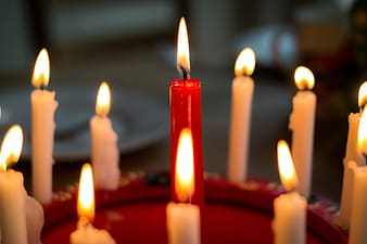 Lighted red and white candles