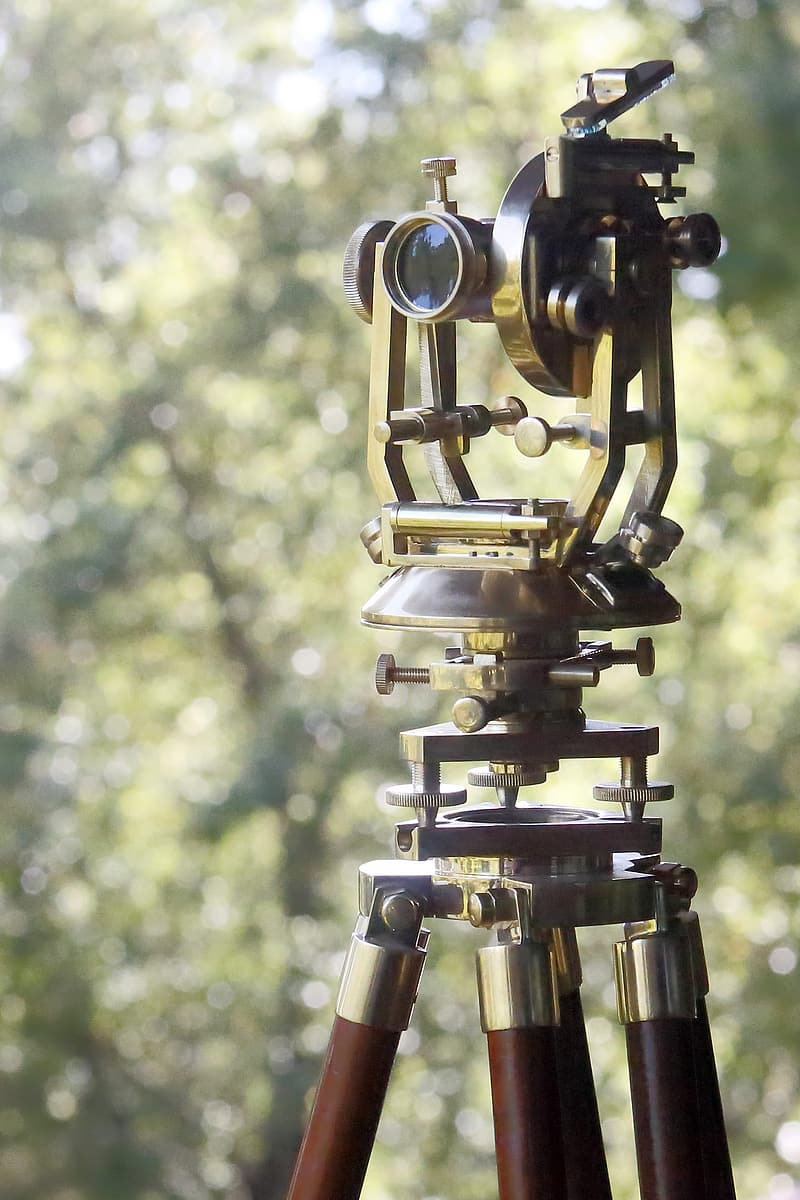 Gold and black telescope with stand