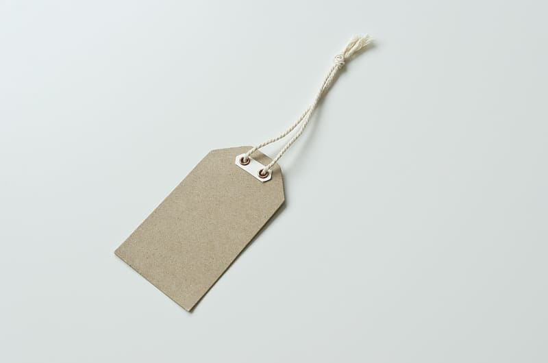 Brown tag on white surface