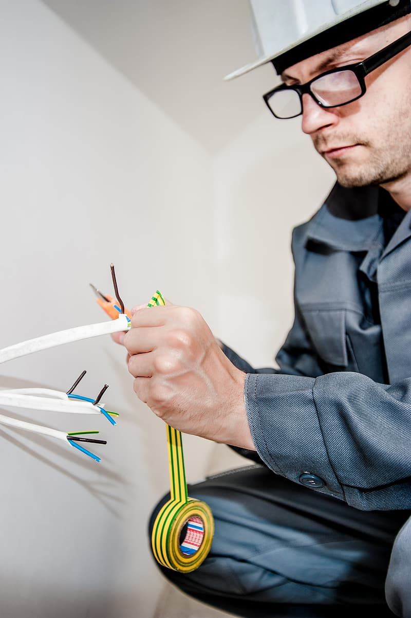 Man working on electric wire