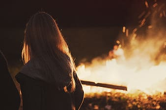 Girl facing the fire