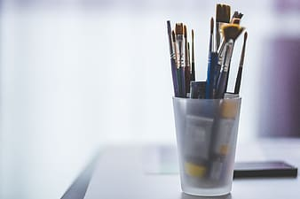 Paint brushes in black cup