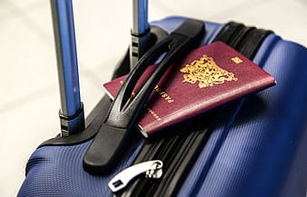Passport on blue travel luggage
