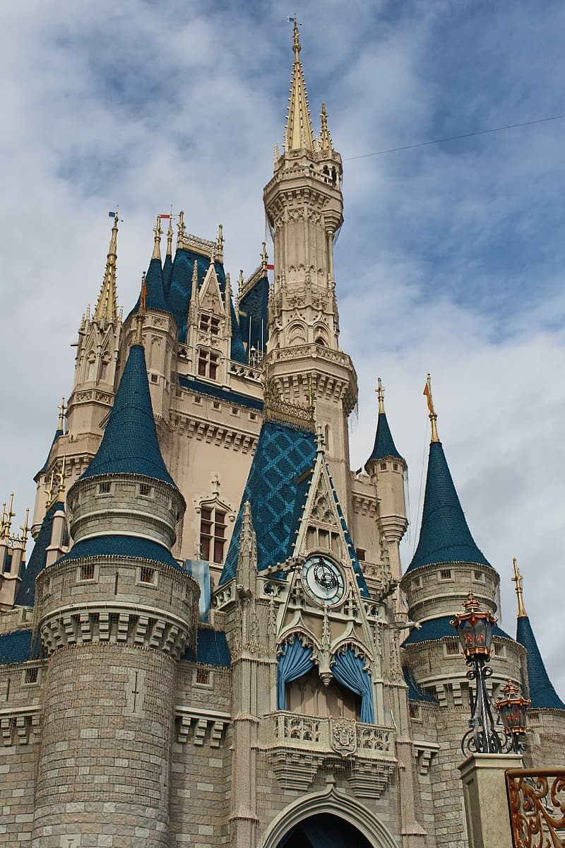White and blue castle under cloudy sky