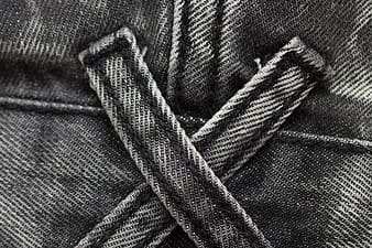 Closeup photo of black denim seam