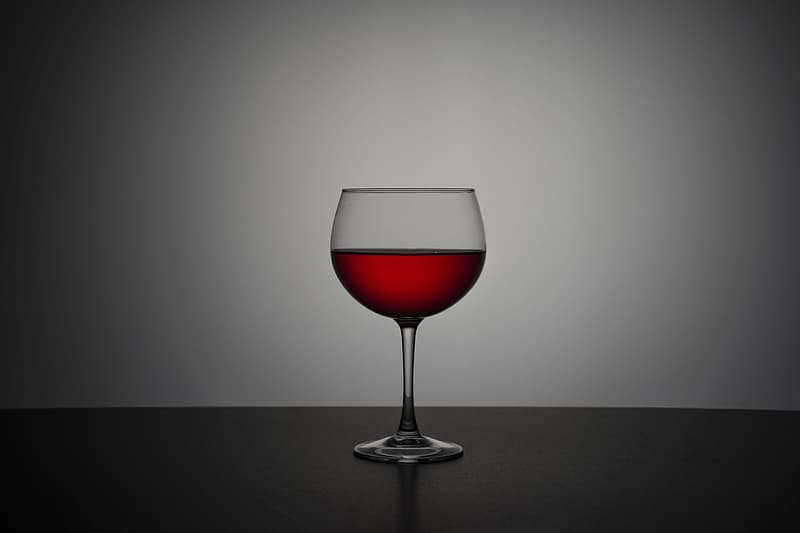 Wineglass with half-filled wine
