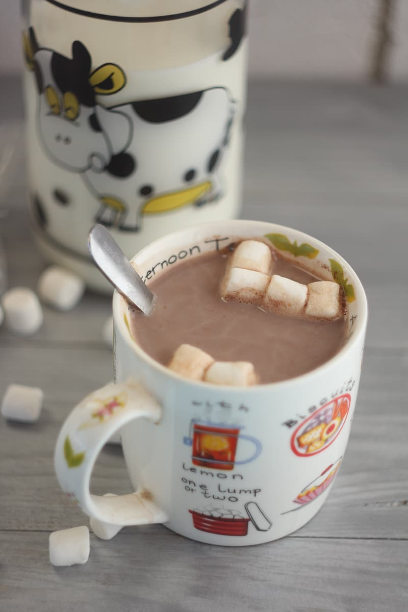 Chocolate drink with marshmallows in white ceramic mug