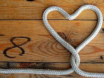 Flat lay photography of heart formed white rope