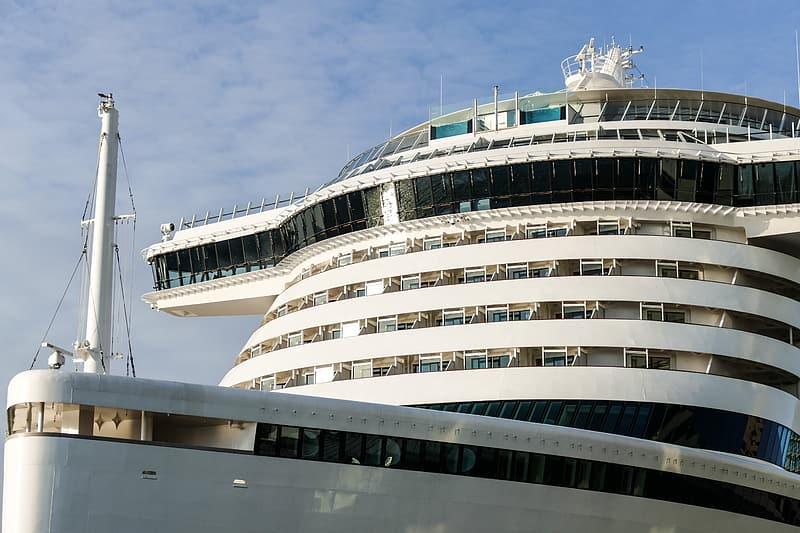 White and black cruise ship under blue sky during daytime