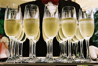 Filled clear glass champagne flutes