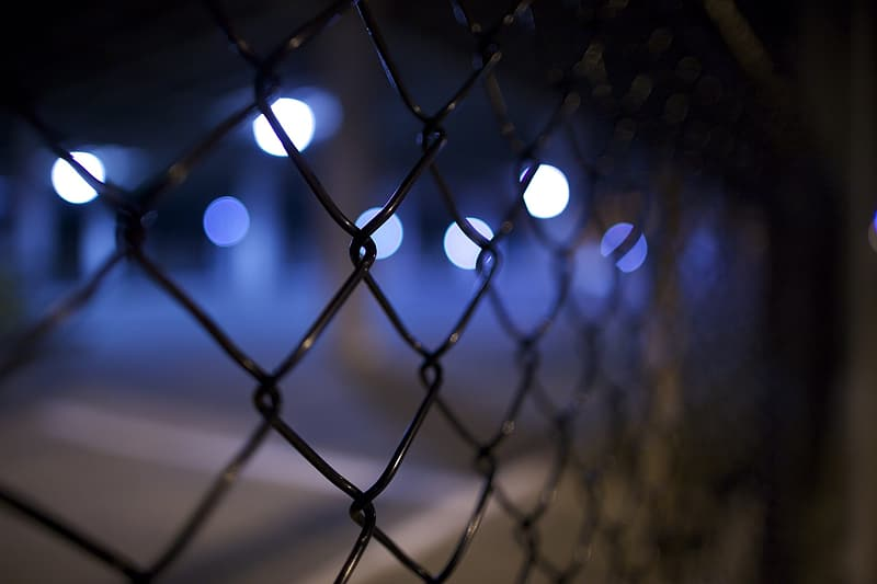 Focus photography of black chain-link fence with bokeh background photography
