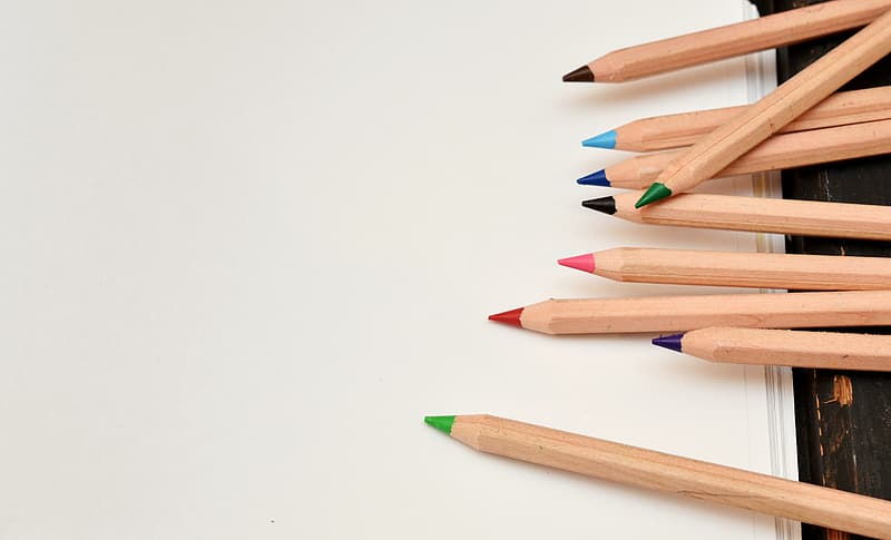 Assorted-color wooden pencil on white surface
