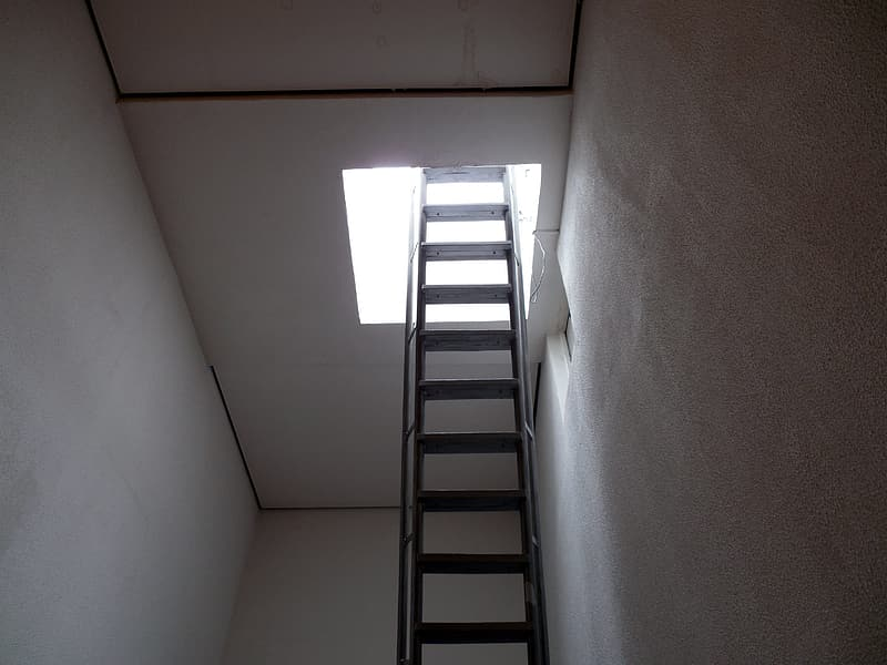 White and gray staircase near white wall
