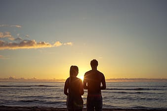 Silhouette couple in front of beach