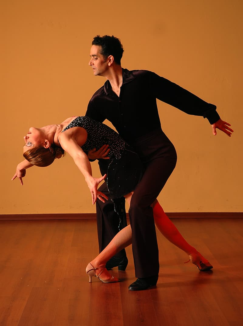 Man and woman dancing on floor