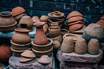 Brown clay pots on stone
