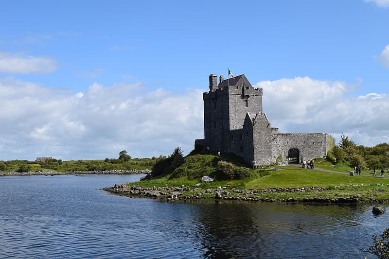 Gray stone castle near body of water