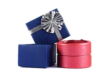 Two blue gift box beside red box against white background