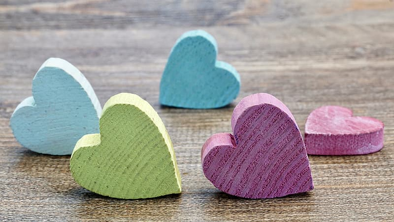 Five multicolored heart table decors