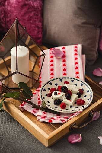 Summer berries with a sweet dessert on a plate in a drawer
