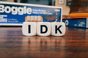 Closeup photography of IDK boggle letter dices on table