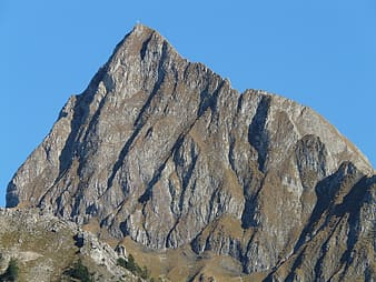 Top view of mountain under blue sky