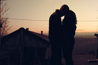Silhouette of a man and woman about to kiss