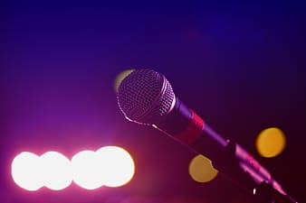 Black microphone with lights on blue background