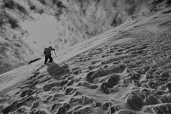Person hiking on snowy mountain