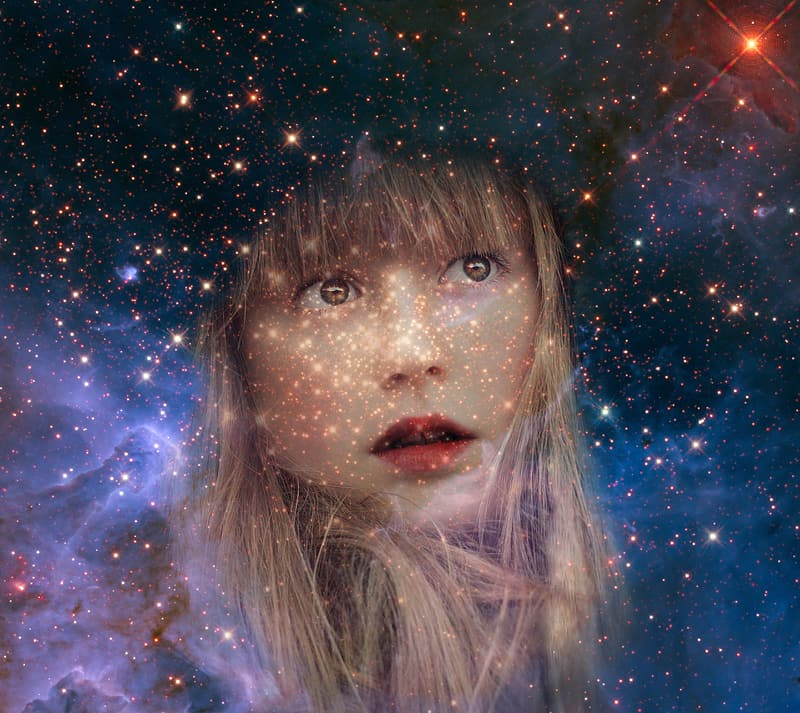 Photo of woman's face staring at stars