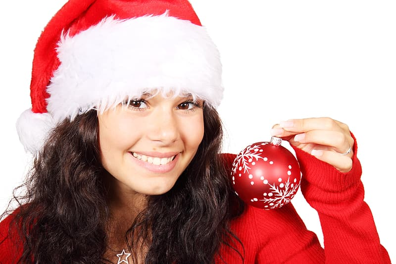 Woman with santa costume holding red baubles