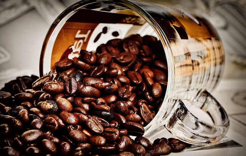 Coffee beans in clear glass jar