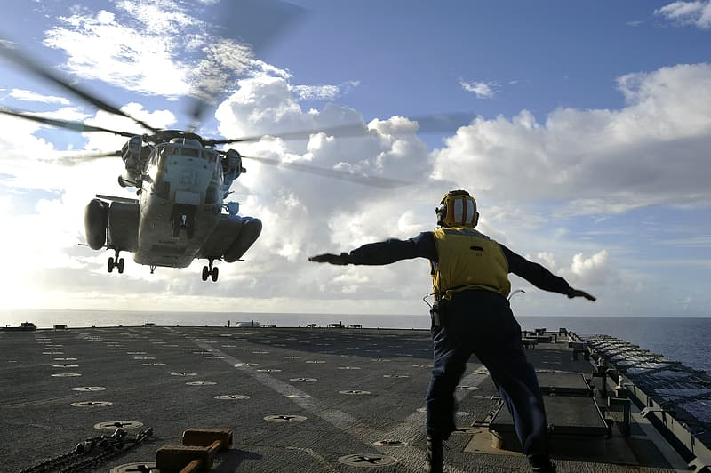 Sailor Directing Helicopter, Landing