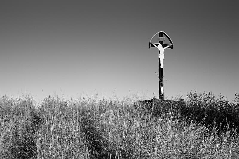Grayscale photo of Jesus on the cross