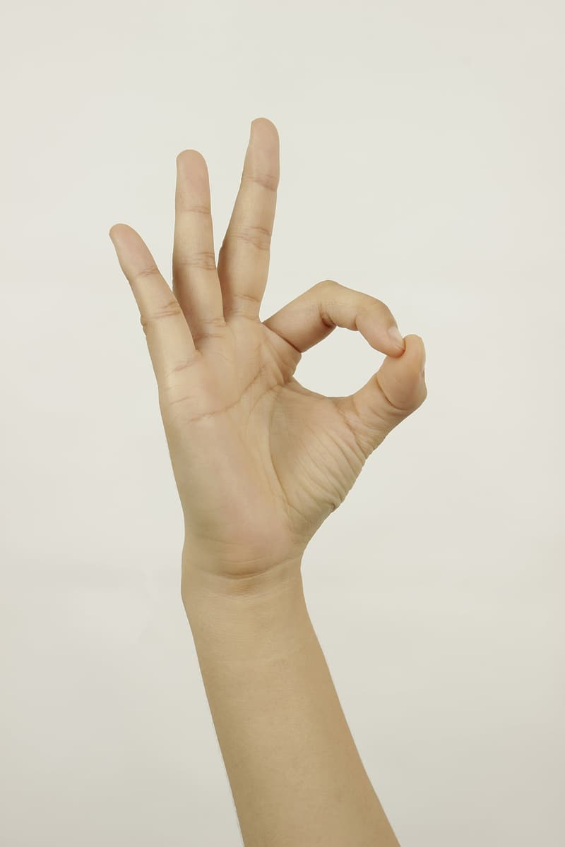 Person showing ok hand gesture