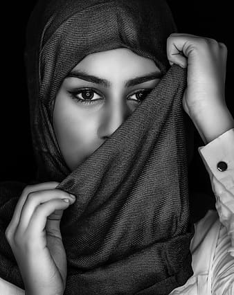 Grayscale photo of woman covering her face with scarf