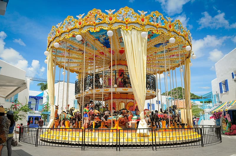 White and brown carousel with people photo