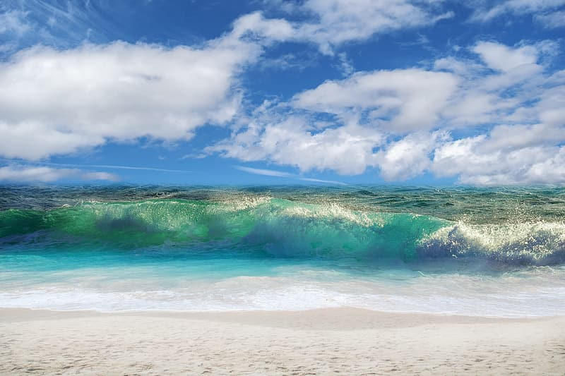Ocean waves under blue sky and white clouds during daytime