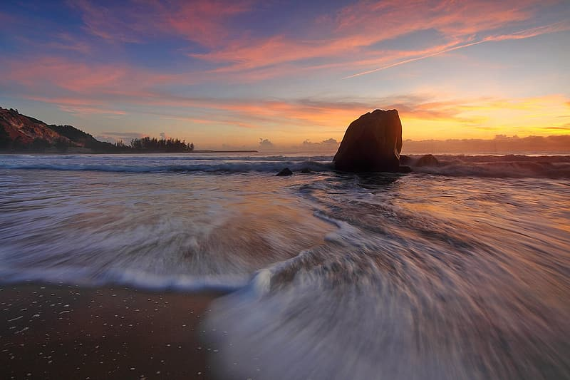 Time lapse of ocean wave during sunset