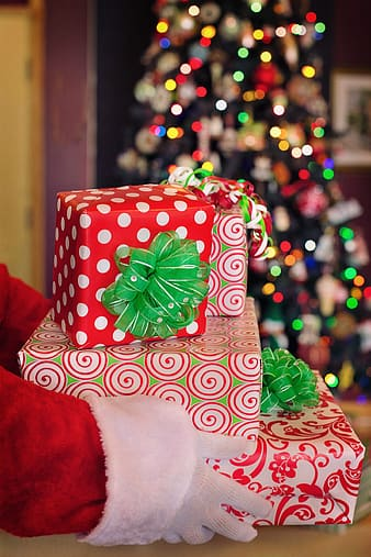 Person holding present boxes