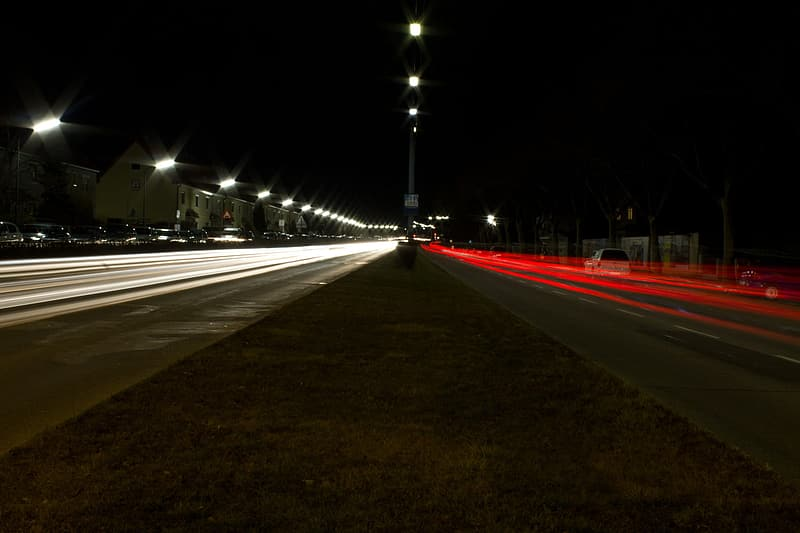 Time lapse photography of light passes on road