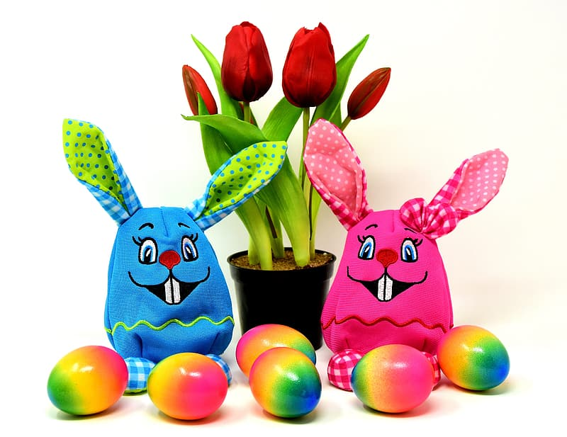 Two blue and red rabbit figurines
