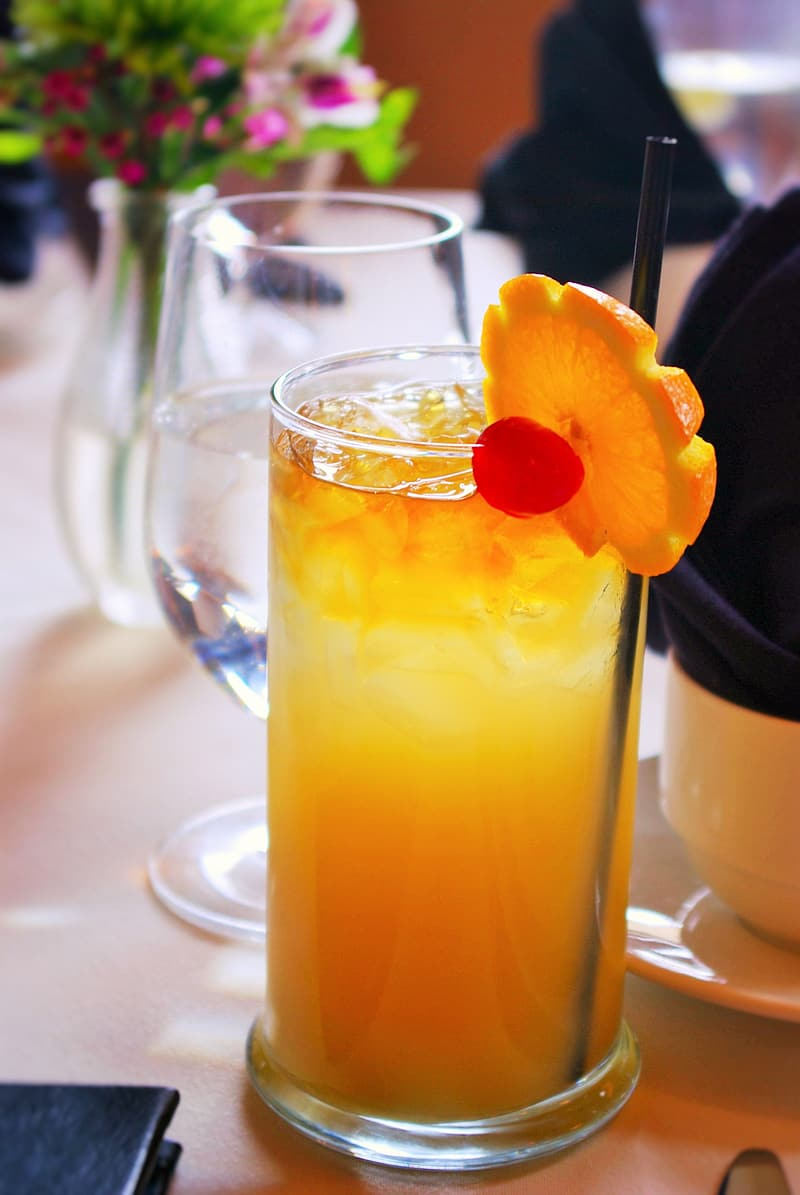 Clear drinking glass filled with orange juice