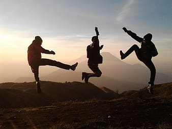 Group of three people doing jump shot