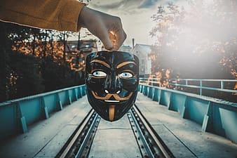 Person wearing black and yellow mask