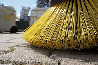 Close-up photography of yellow floor brush