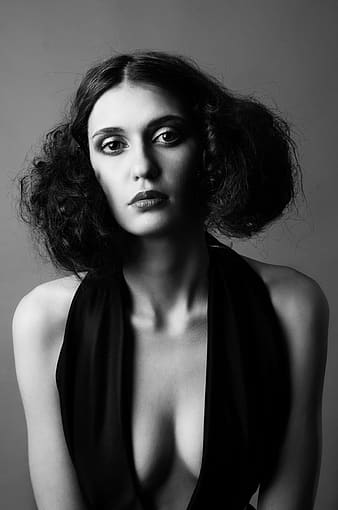 Grayscale photography of woman wearing deep v-neck halter top